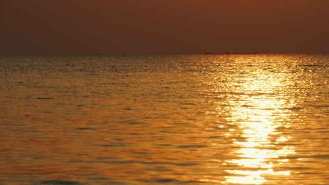 golden reflection of sunset on sea - softness stock videos & royalty-free footage