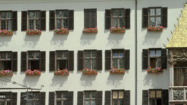ls pan golden roof (german: goldenes dachl) finished 1500, decorated with 2657 fire-gilded copper tiles for maximilian i, holy roman emperor. the reliefs on the balcony show coats of arms, symbols and other figures in his life. - golden roof stock videos and b-roll footage