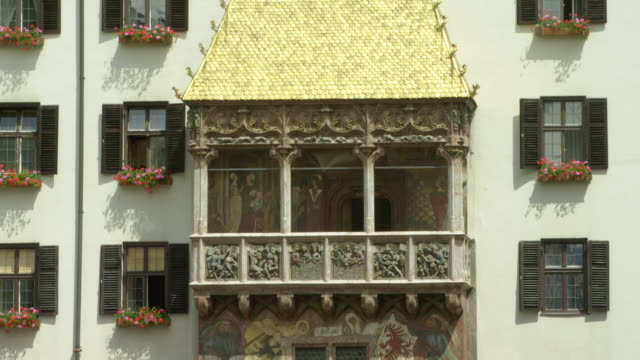 LS TU Golden Roof (German: Goldenes Dachl) finished 1500, decorated with 2657 fire-gilded copper tiles for emperor Maximilian I. The reliefs on the balcony show coats of arms, symbols and other figures in his life. TU ends at Nordkette mountains