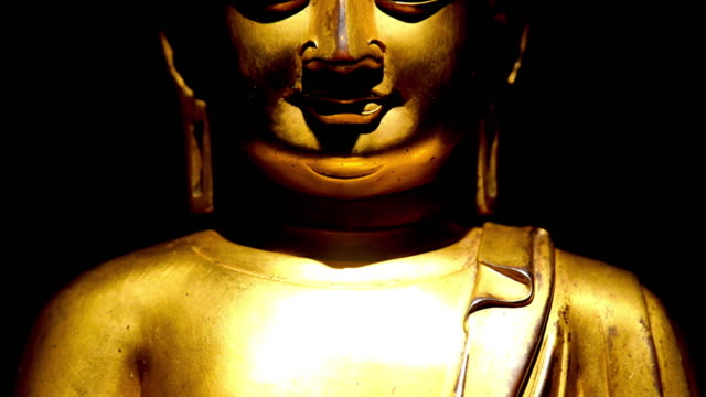 golden sculpture in temple - buddha stock videos & royalty-free footage