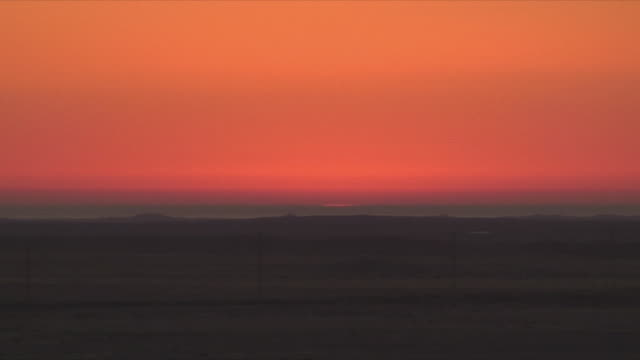 ws golden sky at sunrise / khorixas, namibia - horizon over land stock videos & royalty-free footage