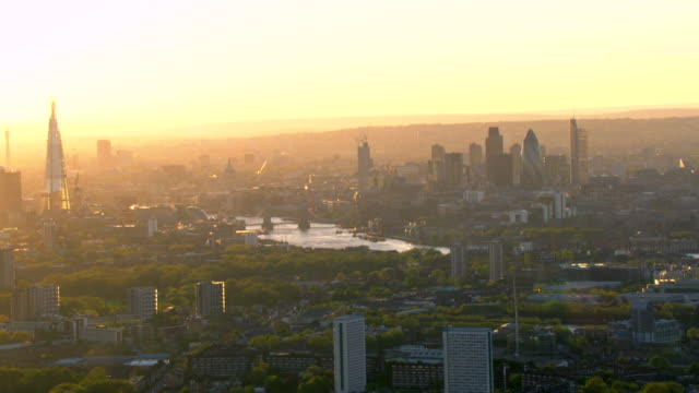 A golden sky glows behind The Shard and the London skyline.
