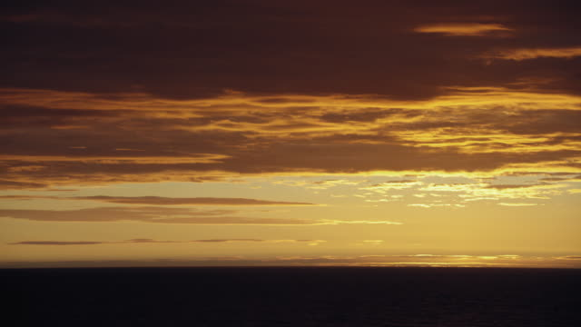 golden sky over sea after sunset - sea passage stock videos and b-roll footage