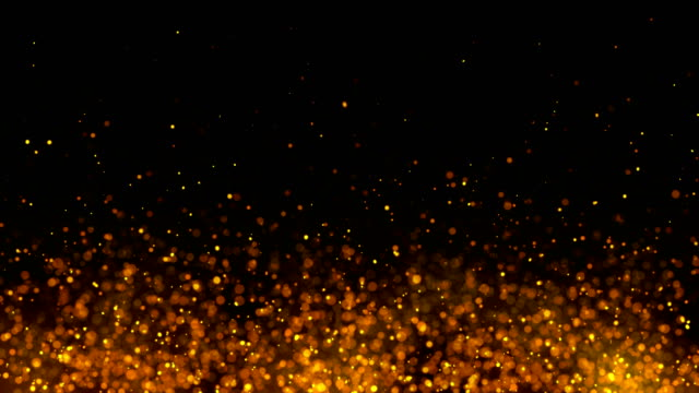 golden sparks like fire isolated on black - particle stock videos & royalty-free footage