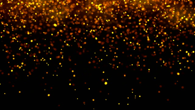 vídeos de stock e filmes b-roll de golden sparks like fire isolated on black - fundo preto