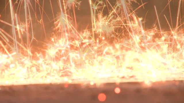 vídeos y material grabado en eventos de stock de golden sparks splatter on a paved floor in a steel factory. available in hd. - cemento