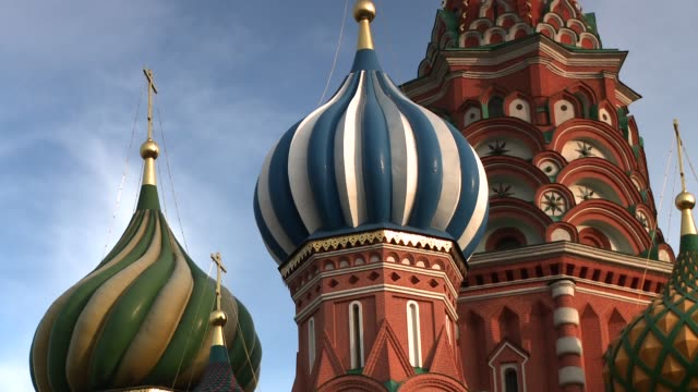 golden spires top the towers at st. basil's cathedral in moscow's red square. available in hd. - st. basil's cathedral stock videos and b-roll footage