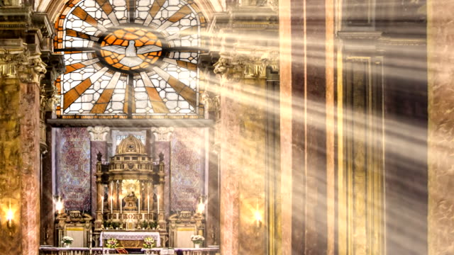 golden stained glass light rays and candles - a forma di croce video stock e b–roll