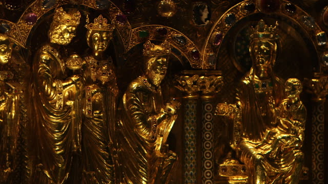 CU Golden statue of infant jesus and virgin mary on tabernacle in Cologne Cathedral / Cologne, Germany