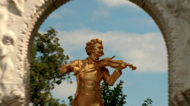 golden statue of musician in picturesque park - zoom - vienna austria stock videos & royalty-free footage