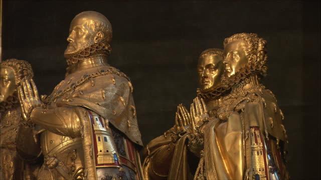 cu pan golden statues in el escorial palace, northwest of madrid, spain - gilded stock videos & royalty-free footage