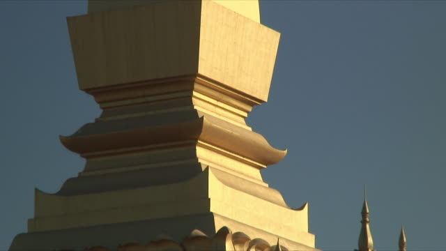cu zo ws golden steeple of buddhist temple / vientiane, laos - steeple stock videos & royalty-free footage