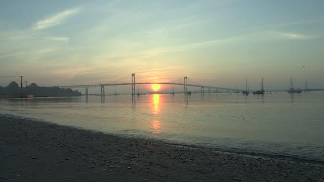 A golden sun rises over a beach in Jamestown, Rhode ISland.