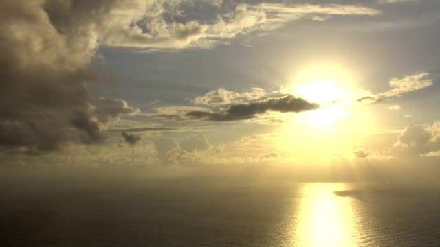 a golden sun shines above the pacific ocean. - pacific ocean stock videos & royalty-free footage