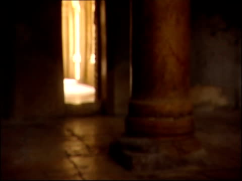 golden sunlight floods in through a skinny doorway in the church of the nativity. - church of the nativity stock videos and b-roll footage