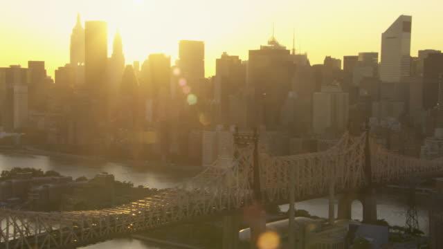 Golden sunlight glows above the New York City skyline.