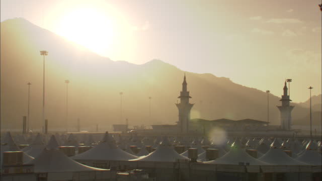 golden sunlight shines across the king abdulaziz international airport in mecca. - saudi arabia stock videos & royalty-free footage