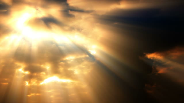 golden sunlight streaks down through sunset clouds. - digital enhancement stock videos and b-roll footage