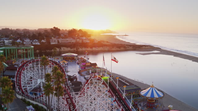 golden sunrise over santa cruz beach and boardwalk - aerial shot - santa cruz california stock videos and b-roll footage