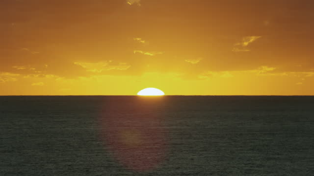 A Golden Sunrise Over The Ocean
