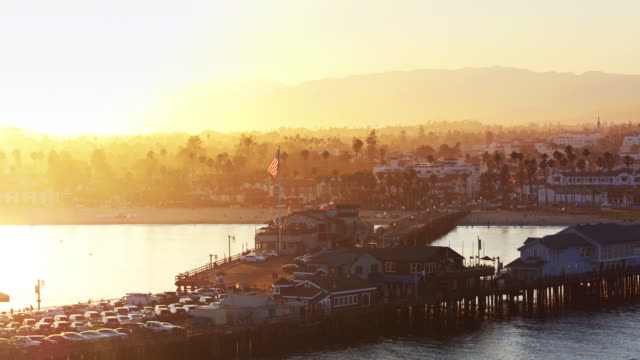golden sunset at stearns wharf, santa barbara - aerial shot - santa barbara california stock videos & royalty-free footage