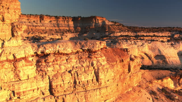 golden sunset light on eagle canyon, utah - drone shot - san rafael swell stock videos and b-roll footage