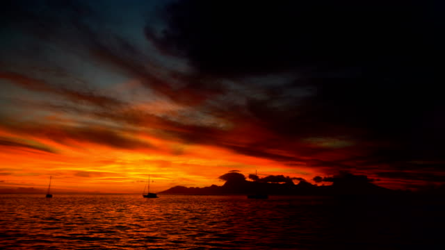 golden sunset moorea island from tahiti south pacific - moorea stock videos and b-roll footage