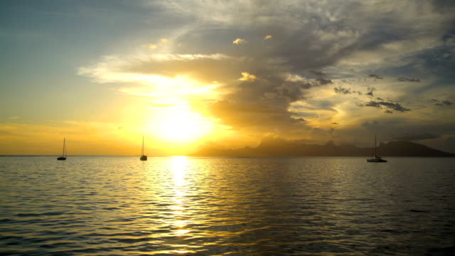 Golden sunset Moorea Island from Tahiti South Pacific