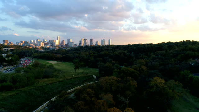 golden sunset nature meets the city as colorful sunset paints the city colors austin , texas - austin texas stock videos & royalty-free footage