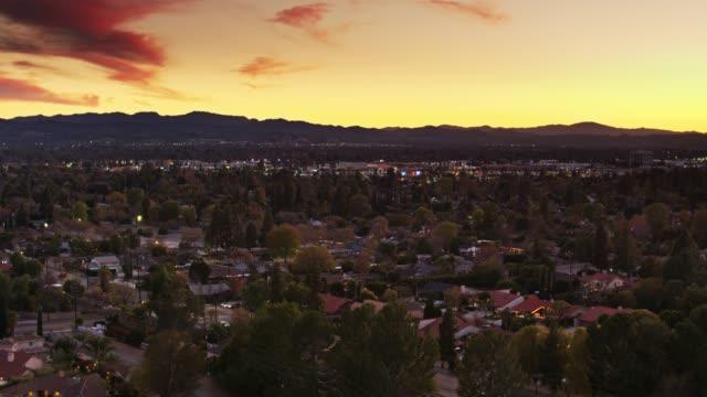 golden sunset over suburban houses in northridge, los angeles - aerial establisher - northridge stock videos & royalty-free footage