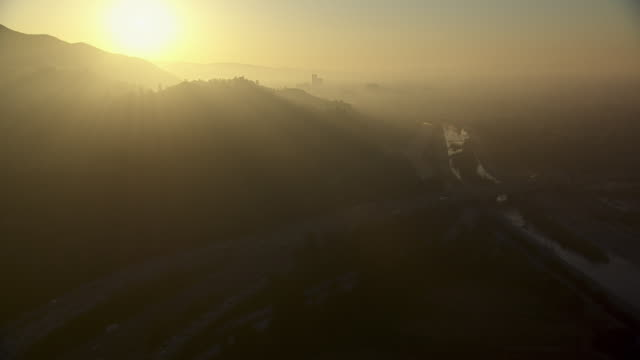 golden sunset over the los angeles river at glendale, california. - glendale california stock videos & royalty-free footage