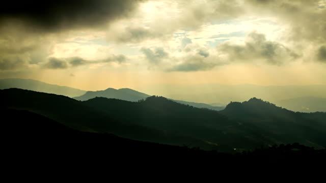 Golden sunset rays over mountain