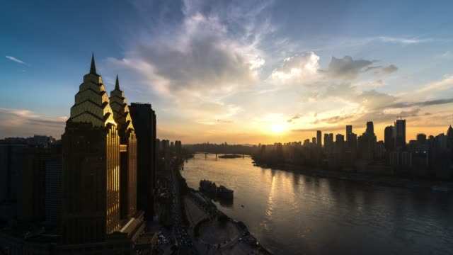 golden sunset to night transition during rush hour above yangtze river city / chongqing, china - sunset to night time lapse stock videos & royalty-free footage