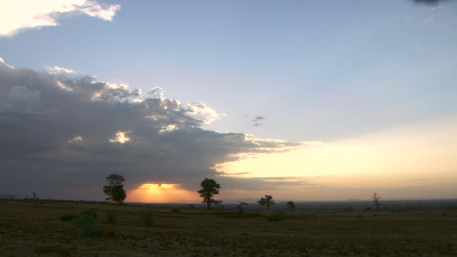 Golden sunshine breaks through dark clouds over the Ethiopian countryside.