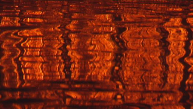 cu, golden temple gurudwara, water surface reflecting harmandir sahib illuminated at night, amritsar, punjab, india - ornate stock videos & royalty-free footage