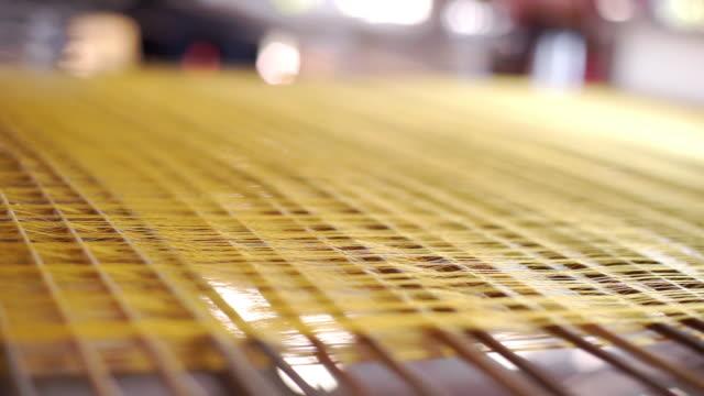 golden threads on a loom, handmade. - silk stock videos & royalty-free footage