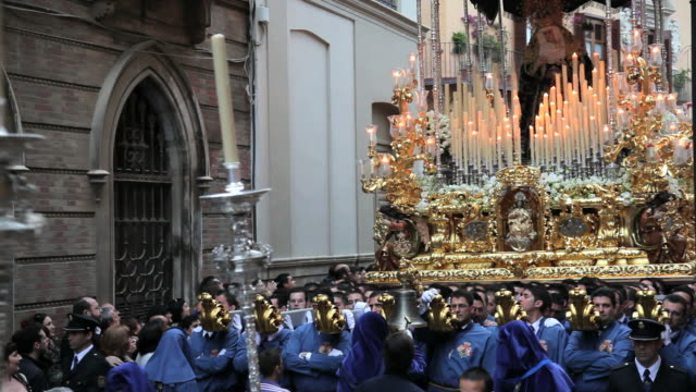golden trono a religious float being carried by the costaleros during semana santa, a procession through the streets of malaga, spain, europe - happy easter stock-videos und b-roll-filmmaterial