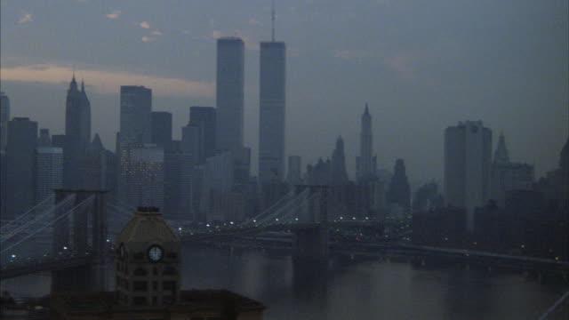 Golden-hour aerial of the Manhattan skyline.