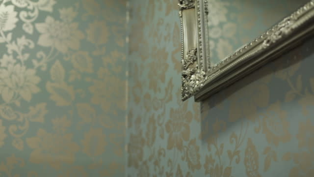 gold-framed mirror and floral wallpaper - domestic room stock videos & royalty-free footage
