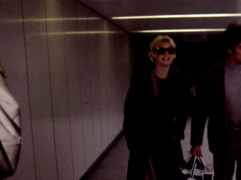 Goldie Hawn arrives at London Airport accompanied by her husband Gus Trinkonis