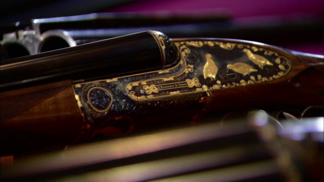 gold-leafed carvings decorate a gun. - gold leaf stock videos & royalty-free footage