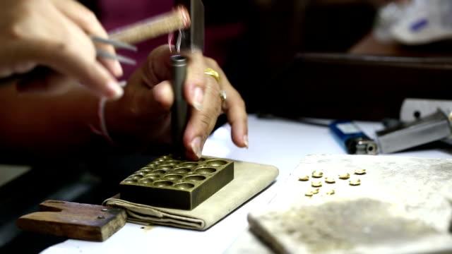 goldsmith jeweler decorating gold - hammer stock videos & royalty-free footage
