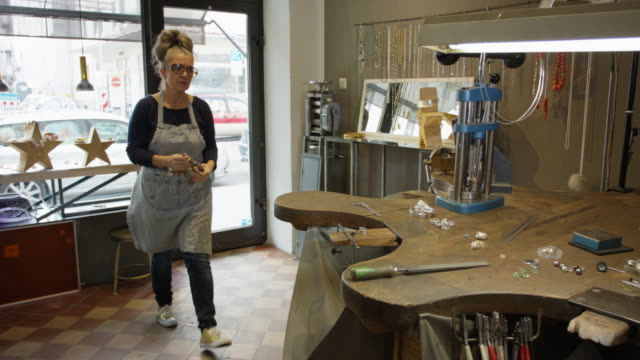 goldsmith workshop and retail shop led by independent master craftswoman. - apron stock videos & royalty-free footage