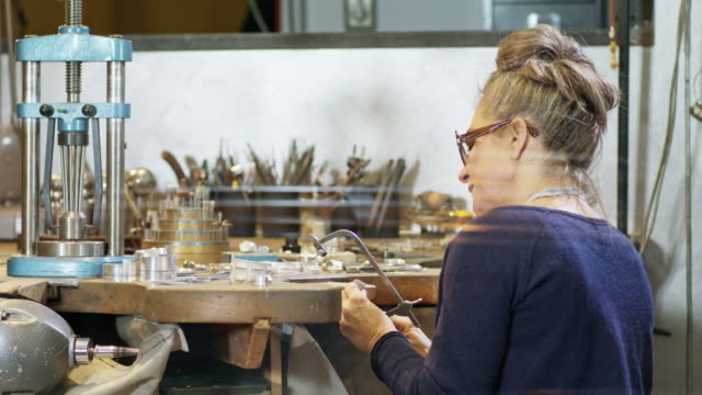 Goldsmith workshop and retail shop run by independent self employed master craftswoman in her 50s.
