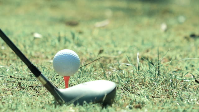 golf ball being hit off a tee - golfer stock videos & royalty-free footage