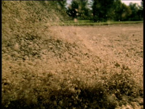 golf ball being hit out of sand trap as sand flies everywhere - golf swing stock videos & royalty-free footage