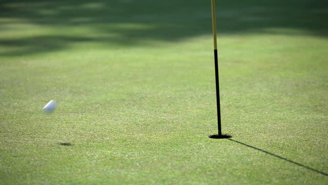 ms golf ball bouncing onto grass and hits pole / canterbury, kent, uk - golf flag stock videos and b-roll footage