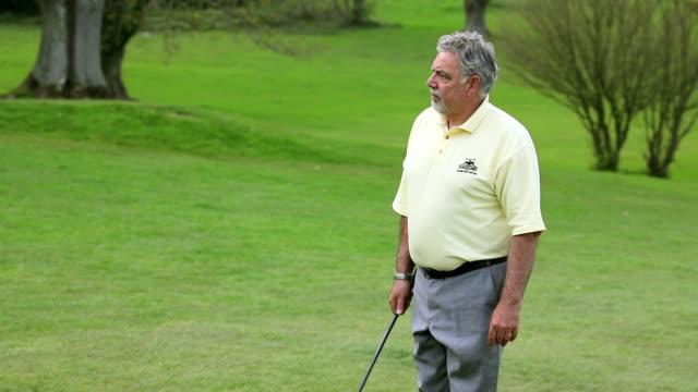 ms golf ball hitting senior man's head / canterbury, kent, uk - surprise stock videos & royalty-free footage