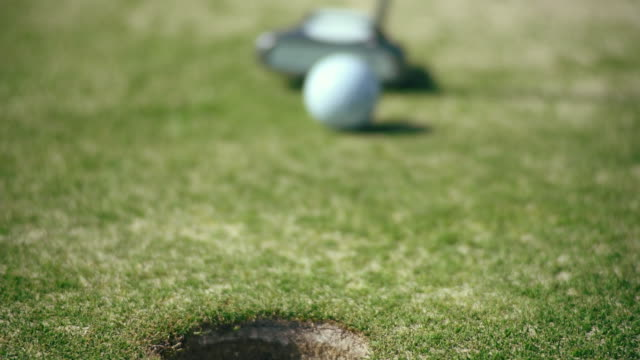 golf ball is hammered in the pocket - golf swing on white stock videos & royalty-free footage