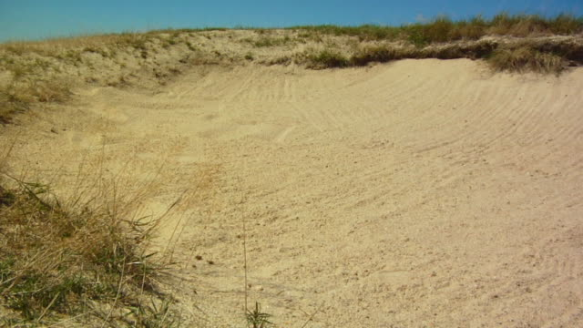 ms, golf ball landing in sand trap, north truro, massachusetts, usa - golf ball stock videos and b-roll footage